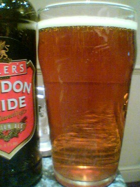 Fuller's London Pride poured into a glass