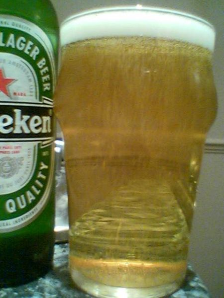 Heineken Imported Lager Beer poured into a glass