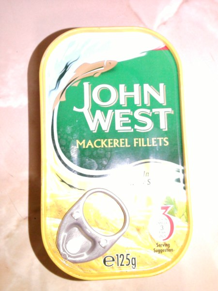 John West Mackerel Fillets In Curry Sauce front of tin