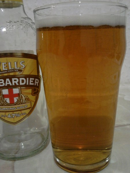 Wells Bombardier Burning Gold poured into a glass